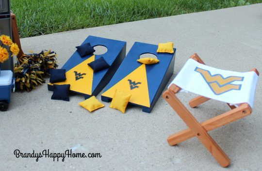 doll cornhole game and collegiate folding chair