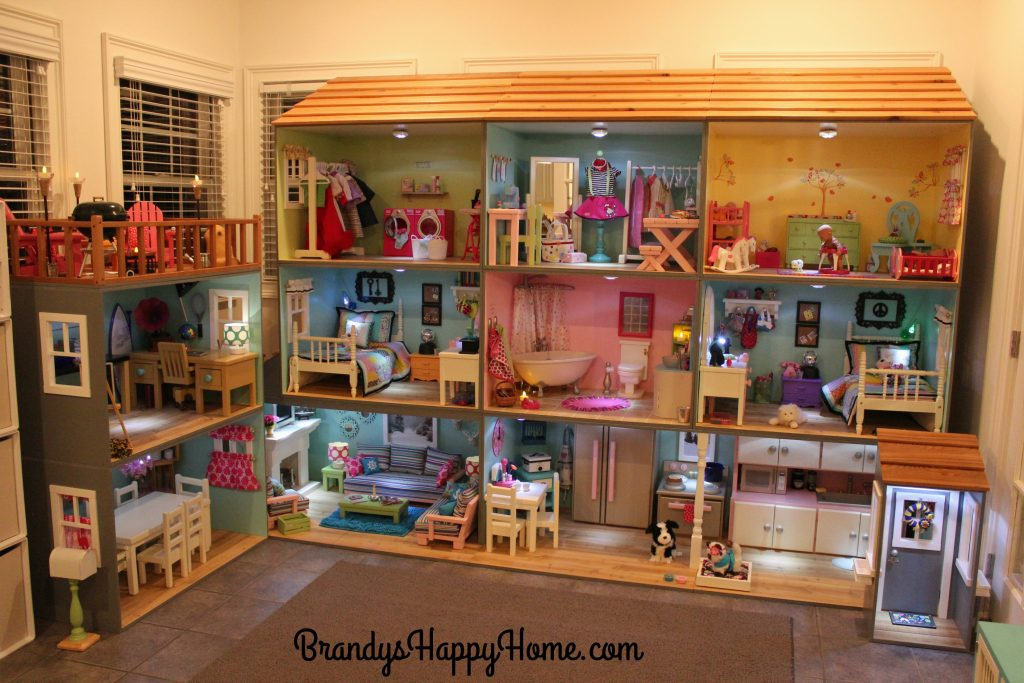 a dolls house Boley pretend play doll house toy - 21 piece collapsible dollhouse, a perfect children's toy with kitchen accessories, light and sound, wallpaper, and more.