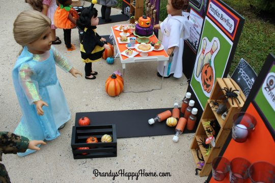 doll-playing-pumpkin-toss-game